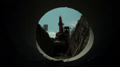 Dredge digs channel, worker jump in hole and marks points from pipes, roadworks. - stock footage