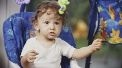 Cute Toddler on a Swing - stock footage