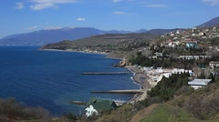CRIMEA. APRIL 2011:The Crimean costline of the Black sea, small settlement and - stock footage