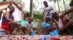 Men sorting sliced meat in plastic bags. Stock Footage