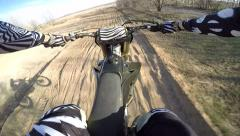 Smooth slow motion of motocross rider jumping and going sideways Stock Footage