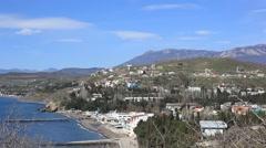 CRIMEA. APRIL 2011:The Crimean costline of the Black sea, small settlement and Stock Footage