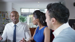 4k Portrait of businessman with colleagues in a business meeting Arkistovideo
