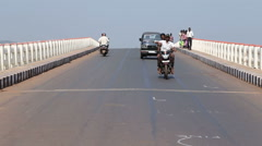 Vehicles and people passing down the bridge in Goa. Stock Footage