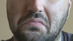 Bearded man mouth closeup, disapproval, disappointment, sad face, disgusted male Stock Footage