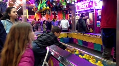 Stock Video Footage of Children got rewards for catching yellow ducks float game