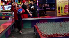 Stock Video Footage of Carnival game of throwing rings over bottle necks.