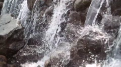 Stock Video Footage of Waterfall cascades flowing over flat rocks