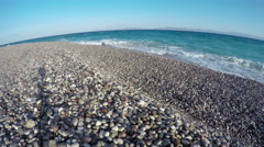 Beautiful resort beach with pebbles in Rhodes island, timelapse 4K Stock Footage