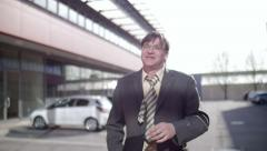Slow motion of a business man walking relieved and happier Stock Footage