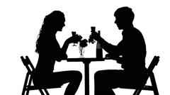 Romantic couple having dinner, clinking glasses. silhouette Stock Footage