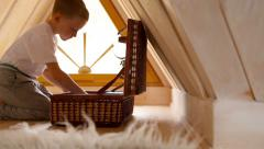 Child room in the house Loft. Boy plays toys. Stock Footage