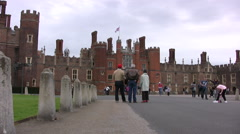 Tourists near entrance to Hampton Court Palace Stock Footage