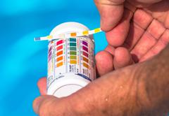 Check the Ph of a private swimming pool Stock Photos