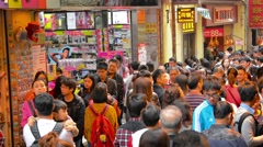 MACAU, CHINA - CIRCA JAN 2015: Crowd of shoppers jostle eachother in the stre Stock Footage