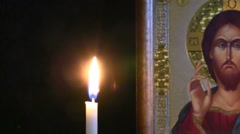 Candle burns near Orthodox icon Stock Footage