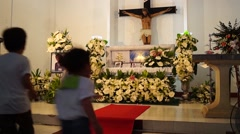 Children play in front of the casket Stock Footage