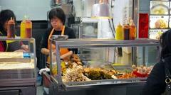 HONG KONG, CHINA - CIRCA JAN 2015: A customer browses  the displayed foods at Stock Footage