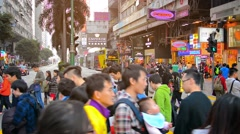 HONG KONG, CHINA - CIRCA JAN 2015: Swarm of pedestrians crossing a major city Stock Footage