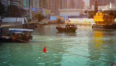 HONG KONG, CHINA - CIRCA JAN 2015: Small ferry boats docking along a canal to Stock Footage