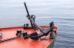 Anchor on the board of small ship Stock Photos
