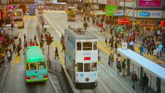 HONG KONG, CHINA - CIRCA JAN 2015: Pedestrians crossing a busy city street at Stock Footage