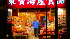 HONG KONG, CHINA - CIRCA JAN 2015: Shoppers wait their turn for service at a - stock footage