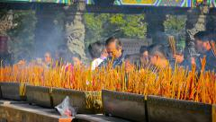 HONG KONG, CHINA - CIRCA JAN 2015: Hundreds of incense sticks smolder as wors Stock Footage
