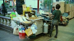 HONG KONG, CHINA - CIRCA JAN 2015: Street food vendor in downtown Hong Kong, Stock Footage