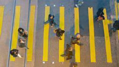 HONG KONG, CHINA - CIRCA JAN 2015: Pedestrians crossing a busy, city street a Stock Footage