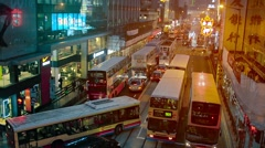 HONG KONG, CHINA - CIRCA JAN 2015: Buses temporarily jam the busy nighttime t Stock Footage