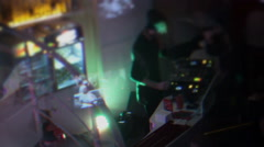 DJ playing club music, people partying, creative visual effect Stock Footage