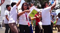 Stock Video Footage of young people cheering at city plaza