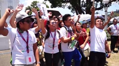 Young people cheering at city plaza Stock Footage
