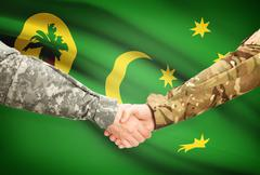 Stock Illustration of Soldiers shaking hands with flag on background - Cocos (Keeling) Islands