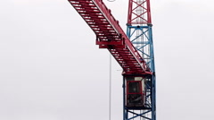 Stock Video Footage of Construction site crane against cloudy sky