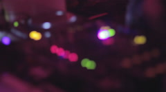 DJ playing soundtracks, nightclub, turntable controls, defocused - stock footage