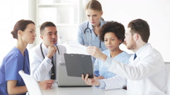 Group of doctors with clipboard talking at clinic Stock Footage