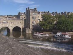 Bath Boulevard + pan Pulteney Bridge crossing the River Avon Stock Footage