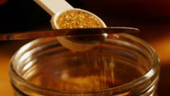 Leveling brown sugar in measuring scoop Stock Footage