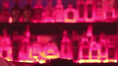 Alcoholic drinks, bottles on bar shelf, bartender serving drinks Stock Footage