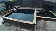 3 large timber built garden ponds 2 Stock Footage