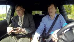 Two business men driving lost and nervous - stock footage