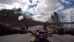 3 motorcycles on scenic road along water Stock Footage