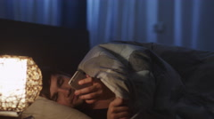 Man Using Phone Before go to Sleep and Switching Off Night Light - stock footage