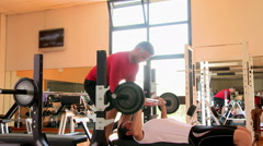 Bench press at gym Stock Footage