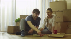 Couple is Eating Pizza In New House after Moving - stock footage
