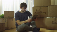 Man Using Tablet in New House House After Moving Stock Footage