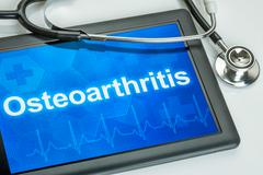 Tablet with the diagnosis Osteoarthritis on the display - stock photo