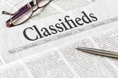 A newspaper with the headline Classifieds - stock photo